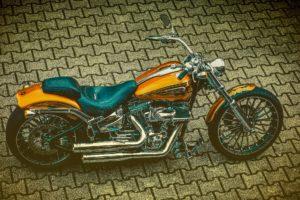 Harley Davidson orange and black bike.