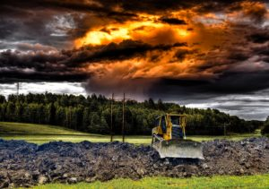 Bulldozer with colorful clouds.