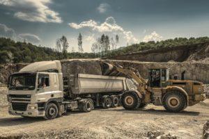 Excavator loading a truck.