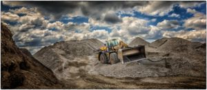 Excavator in a sand pit.