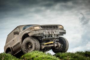 Very muddy off road car.