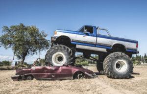 Monster truck over cars.
