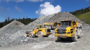 Dump trucks in quarry.