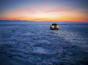 SUV driving on ice.