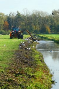 Ditch dredging tractor.