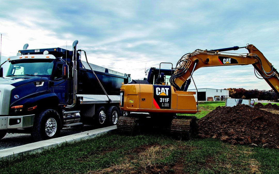 """Featured imaged for """"Engine Oil Grades for Diesel Engines"""" blog post. CAT excavating equipment."""