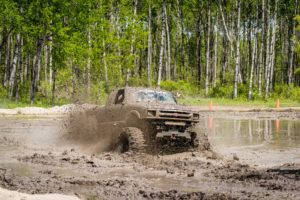 Large pickup truck in the mud.