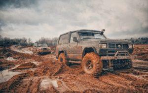 Offroad trucks in mud,