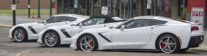 White Corvette cars.