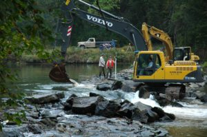 Heavy equipment in a stream.