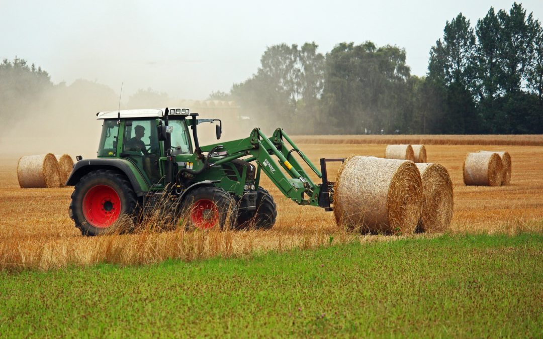 """Feature image for """"Oil for Diesel Tractor Engines"""" blog post. Green harvester tractor."""