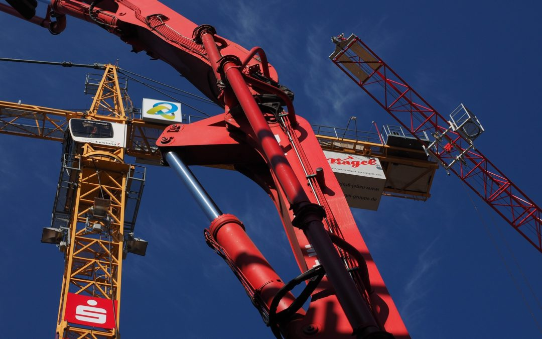 """Featured image for """"Hydraulic Oil Life Expectancy"""" blog post. Hydraulic crane."""