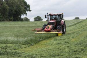 Farm lawn mowing tractor.
