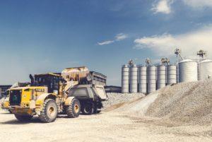 Tractor loader in gravel pit.