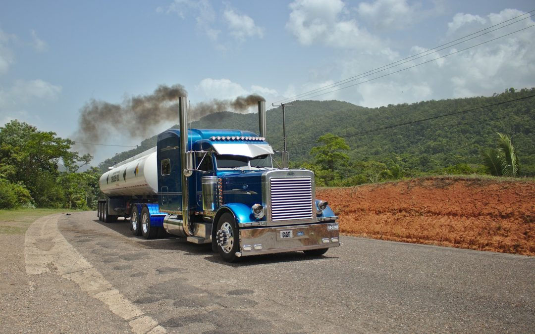 """Featured image for """"Best Diesel Additive to Clean Injectors"""" blog post. Peterbilt truck."""