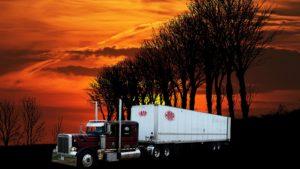 Semi truck at sunset.
