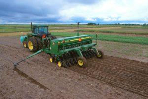 John Deere tilling tractor.