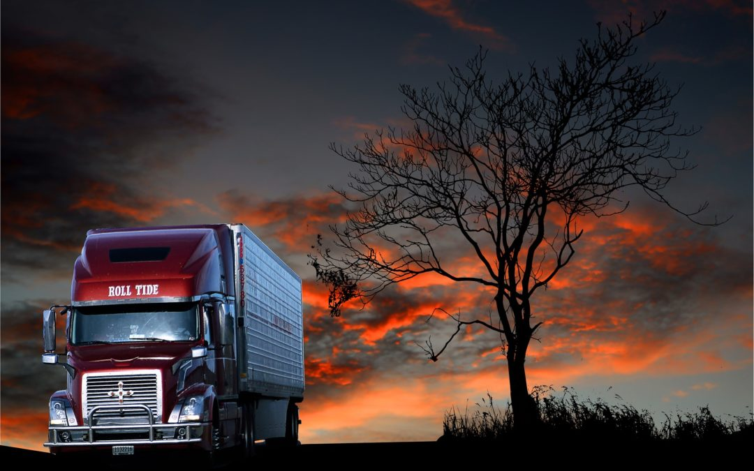 """Featured image for """"How to Get Better Fuel Mileage in a Semi Truck"""" blog post. Semi truck sunset."""