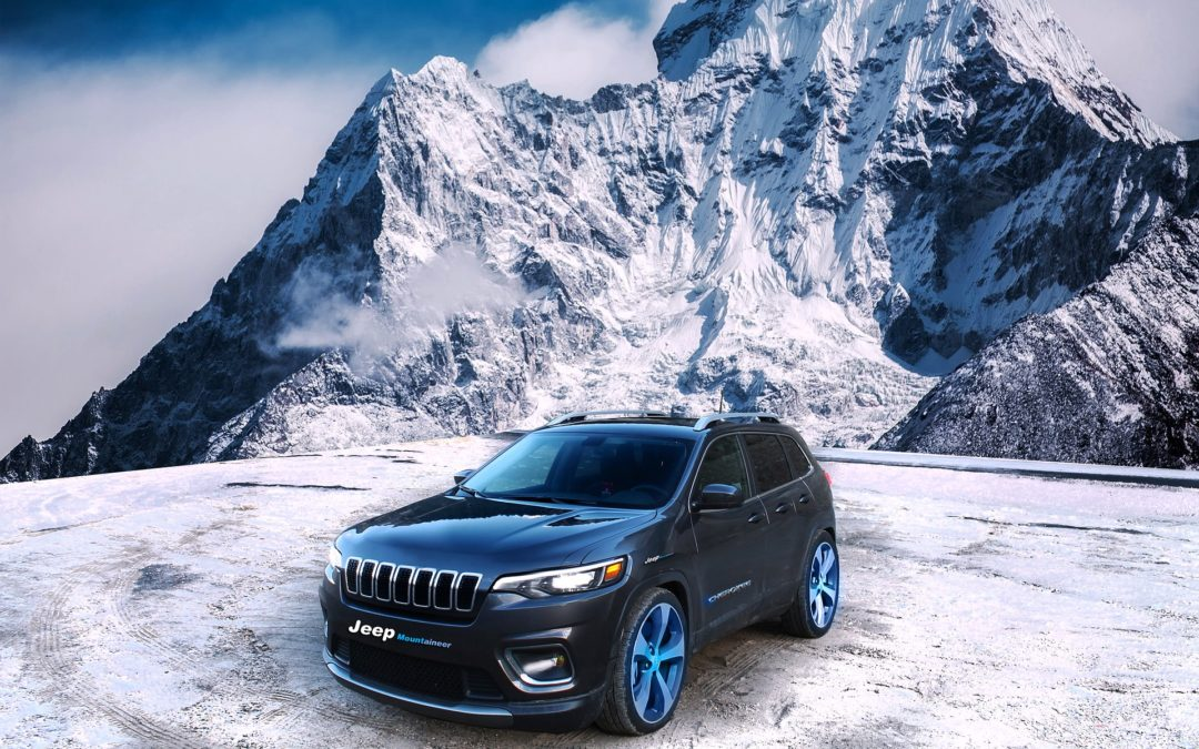 "Featured image for ""What is the Best Oil to Use in the Winter?"" blog post. Jeep below a mountain."