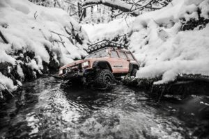 Jeep in snowy water.