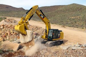 Excavator moving rock.